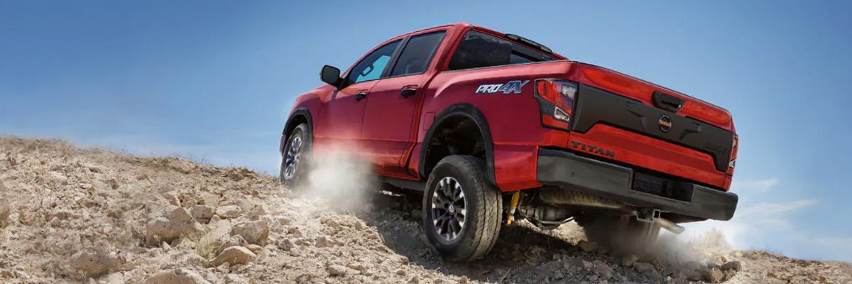 2020 nissan titan driving up rocky terrain