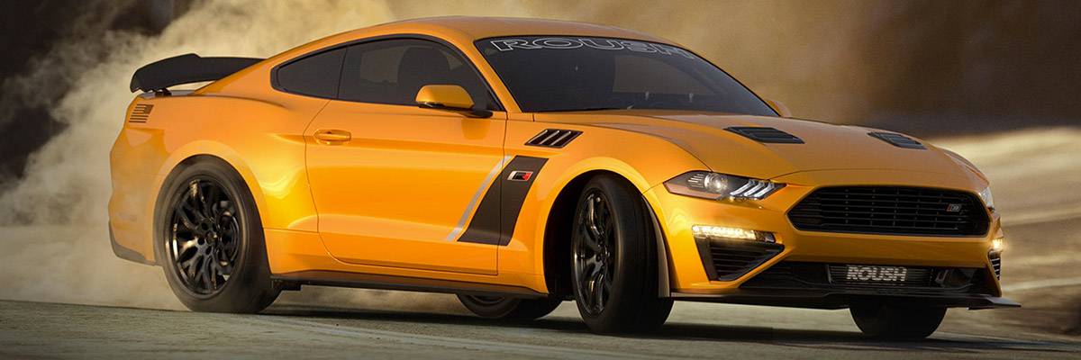 yellow mustang Roush Performance Vehicle drifting on a curve