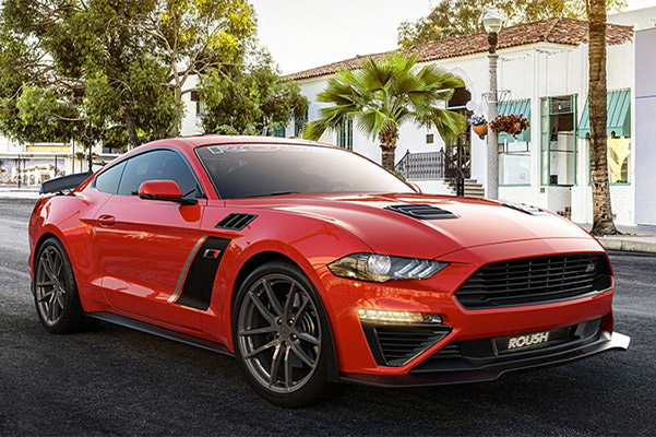 red mustang Roush Performance Vehicle parked on a street with palm tress in the background